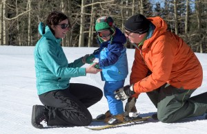 Lisa Lamberson and her dad, Mark, are teaching Lisa's son, Jack, how to ski at Arizona Snowbowl – a tradition for the Mountain Sports Flagstaff family. Courtesy photo Cameron Clark Photography
